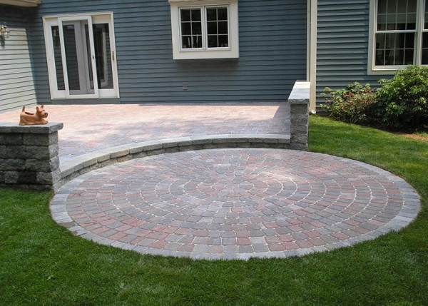 multi-level paver patio with sitting walls by bahler brothers in Connecticut