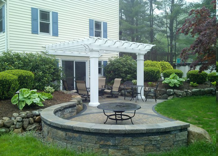 paver patio with sitting walls and pergola by bahler brothers in Simsbury, CT