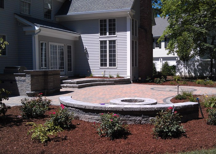 paver patio in Farmington, CT with a sitting wall, fire pit and built-in outdoor kitchen, bar and grill by bahler brothers