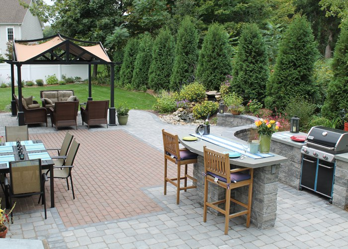 expanded patio to include built-in grill, sitting wall and water feature by bahler brothers in South Windsor, CT