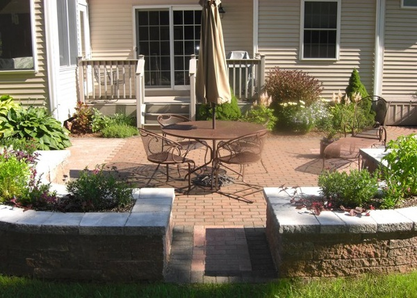 Patio with built-in raised planting beds by bahler brothers in South Windsor, CT