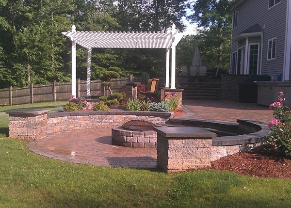 multi-level paver patio in Tolland, CT with fire pit, sitting walls, steps, built-in bar and grill by bahler brothers