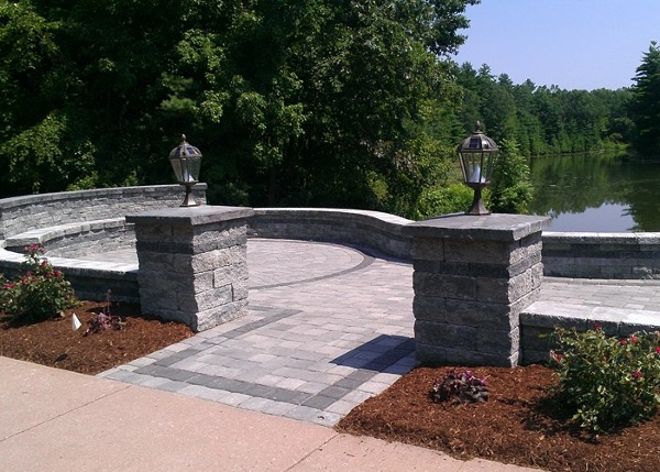 raised paver patio with sitting walls and pillars in Bloomfield, CT by bahler brothers
