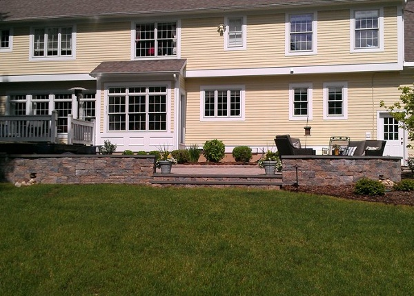 raised paver patio with sitting walls and steps in Simsbury, CT
