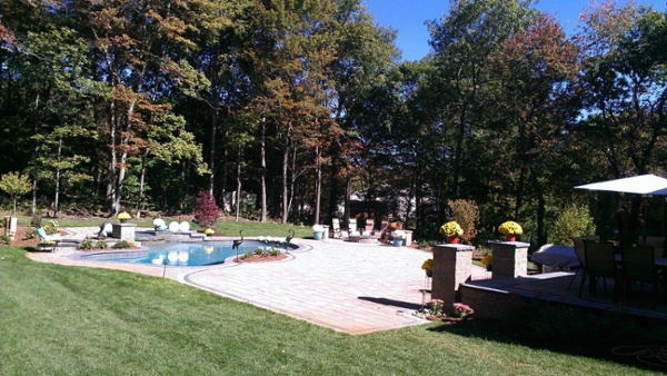 Aqua Pool with paver patio and landscaping by Bahler Brothers in Wolcott, CT