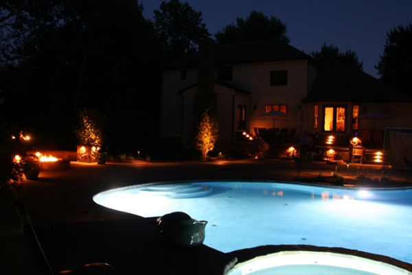 Pool patio with landscape lighting in Wolcott, CT by Bahler Brothers