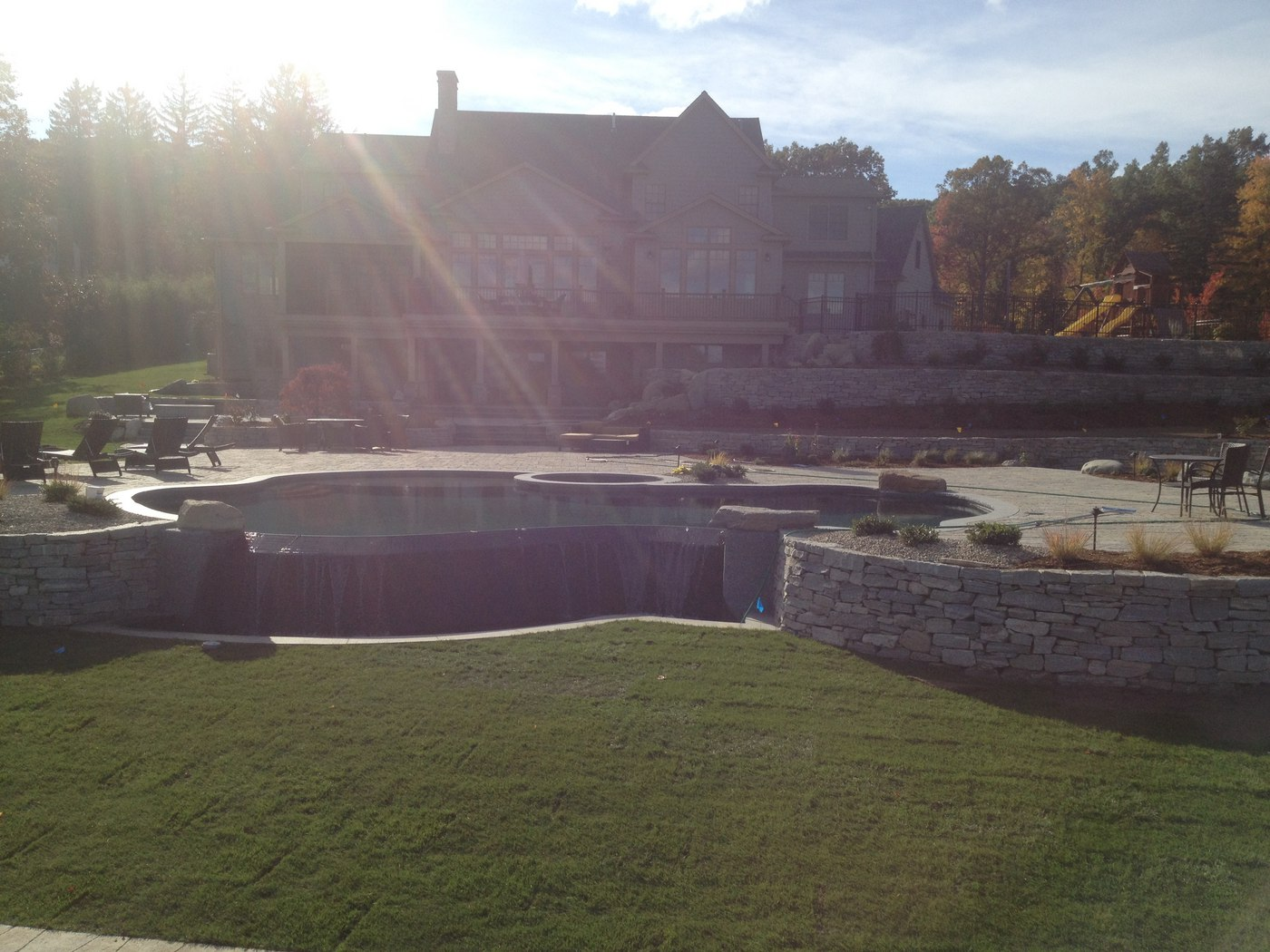 Pool patio and retaining walls by Bahler Brothers in Wilbraham MA