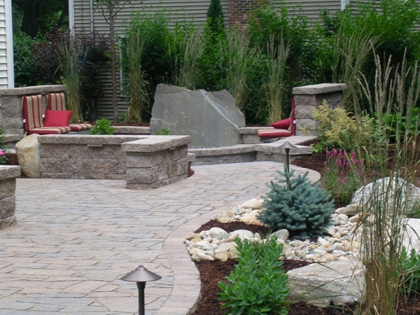 Landscaping surrounds a contemporary patio by Bahler Brothers in CT