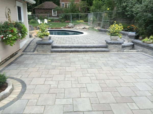 Paver pool patio with steps and retaining walls by Bahler Brothers in West Hartford, CT