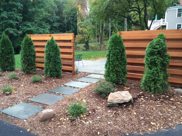 Blue stone Stepping Stones through cedar panels and landscaping by Bahler Brothers in CT