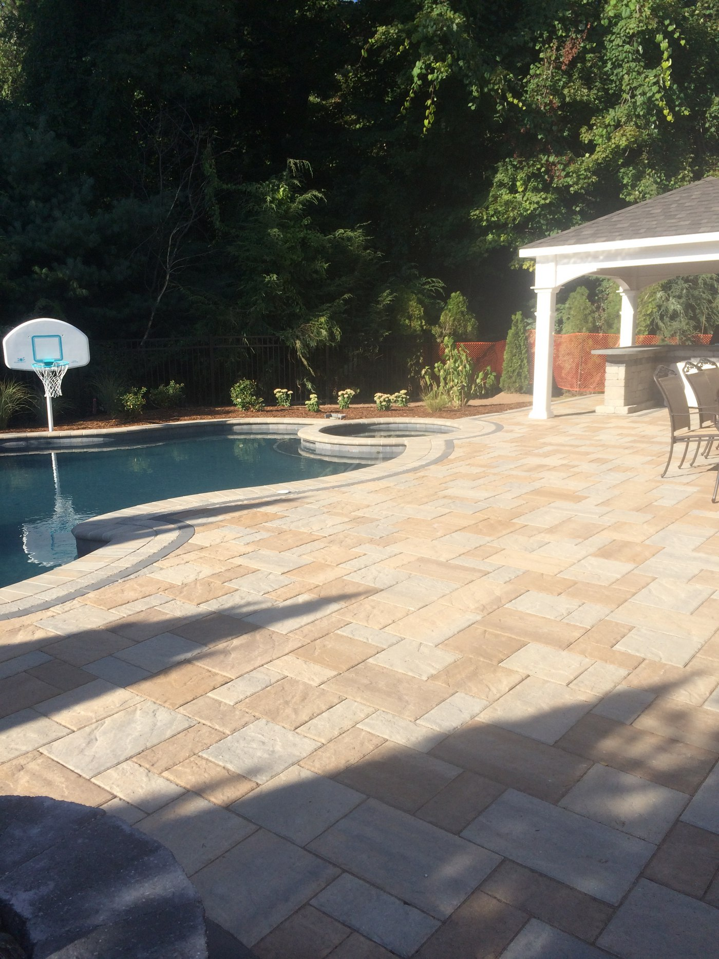 Pool patio with pavilion, outdoor kitchen and landscaping by Bahler Brothers in Farmington, CT