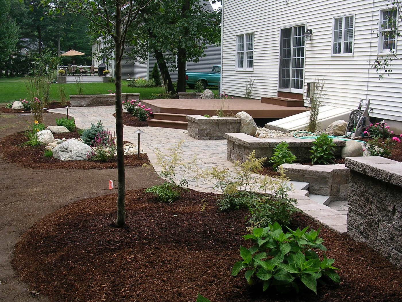How Many Landscaping Bricks Do I Need : How much does a deck cost vs paver patio