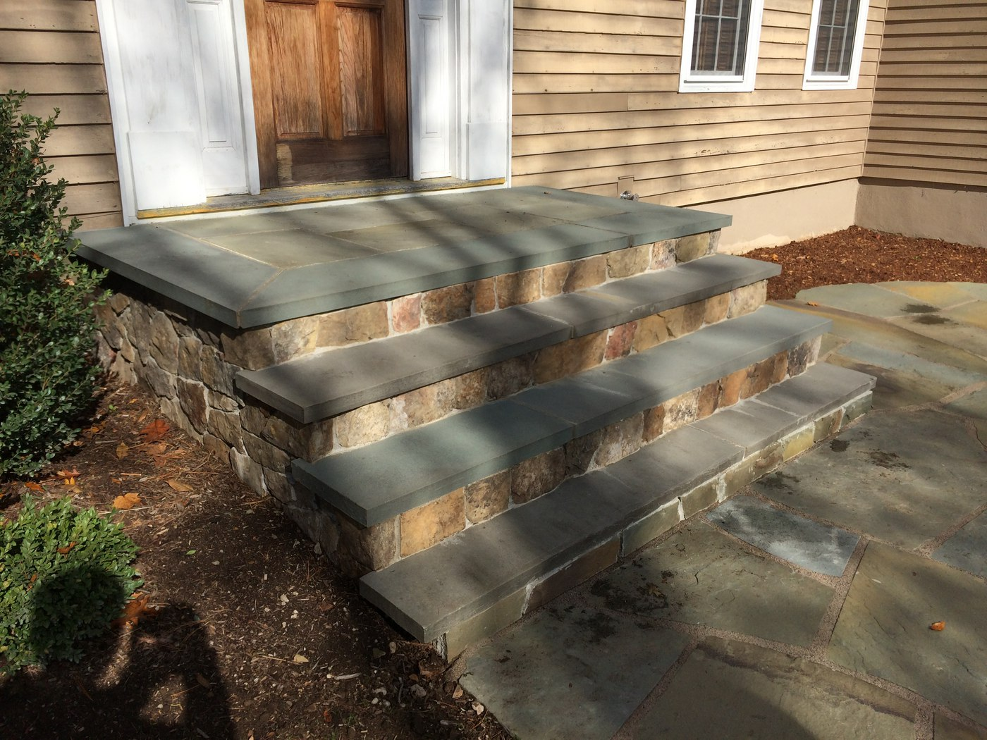 Stone Veneered Steps with Bluestone cap and Flagstone Patio in Simsbury, CT by Bahler Brothers
