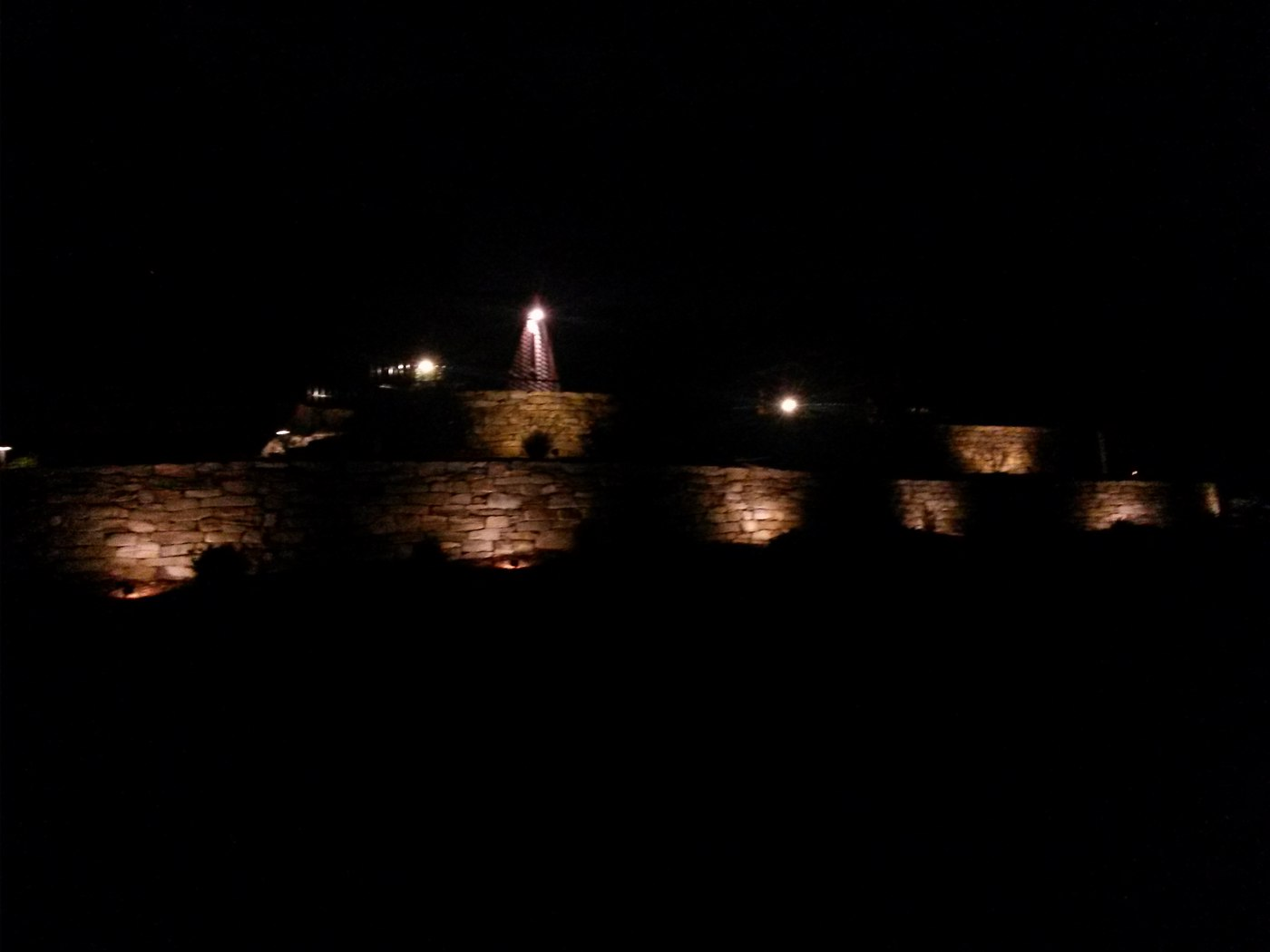 Landscape Lighting installed on a Stone Wall by Bahler Brothers