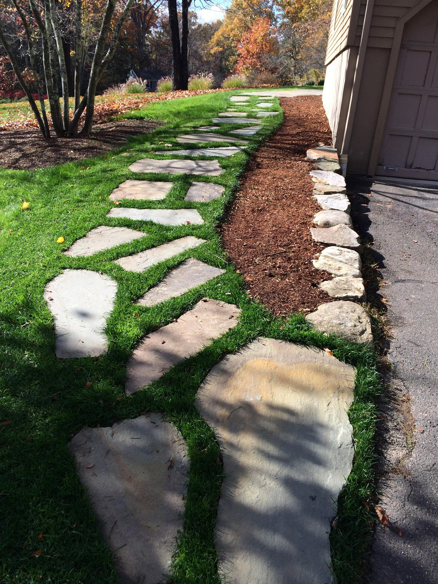 Flagstone Walkway through grass lawn surface by Bahler Brothers in Simsbury, CT