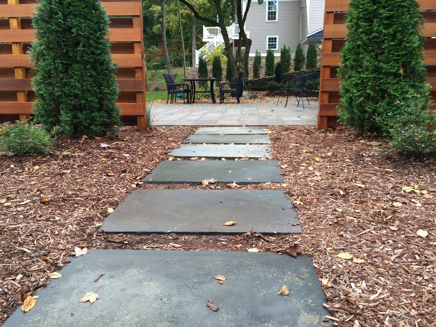 Bluestone Stepping Stones through a landscape bed in West Hartford, CT