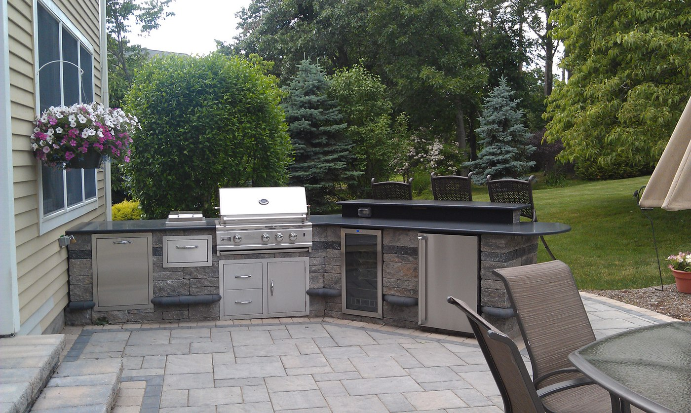 Outdoor Kitchen with bar and Built-in Grill by Bahler Brothers in CT