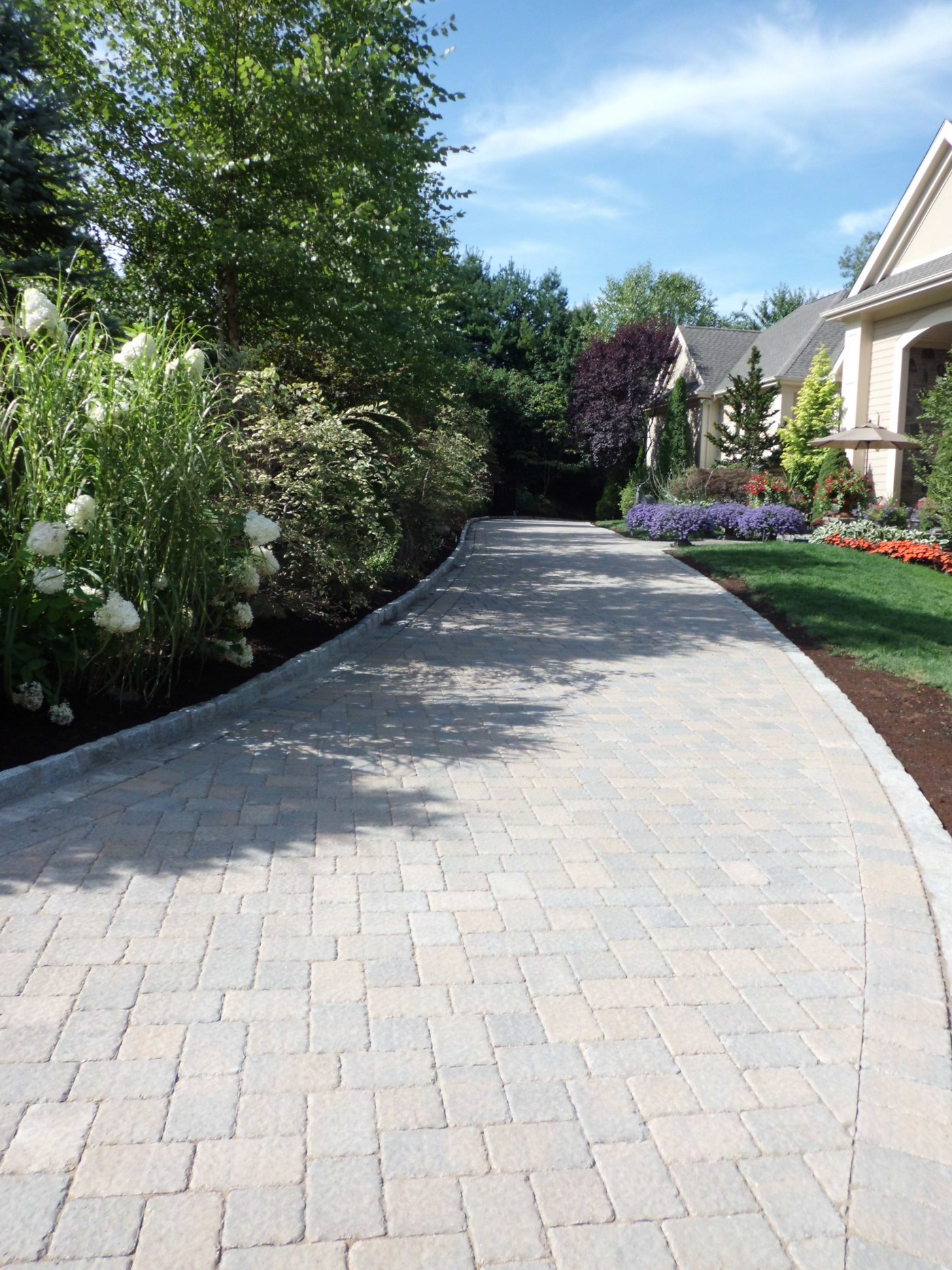 Landscaping Complements a Paver Driveway