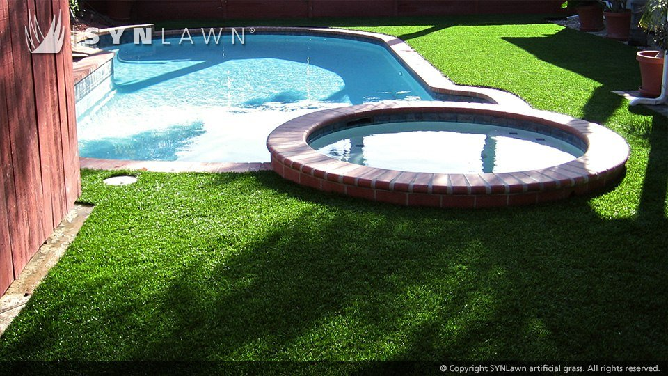 pool area with artificial turf