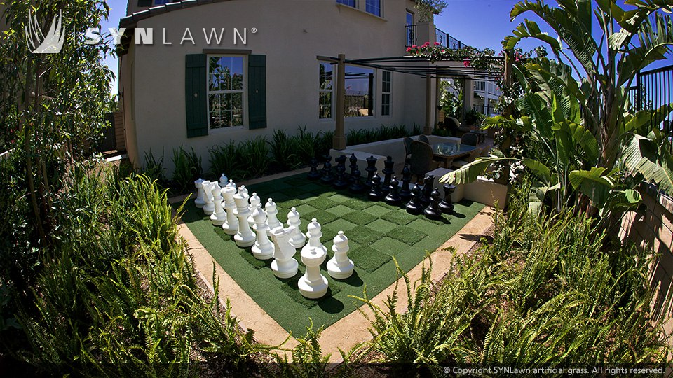 lawn sized chess game in artificial turf