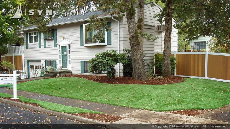 shady front lawn of artificial turf