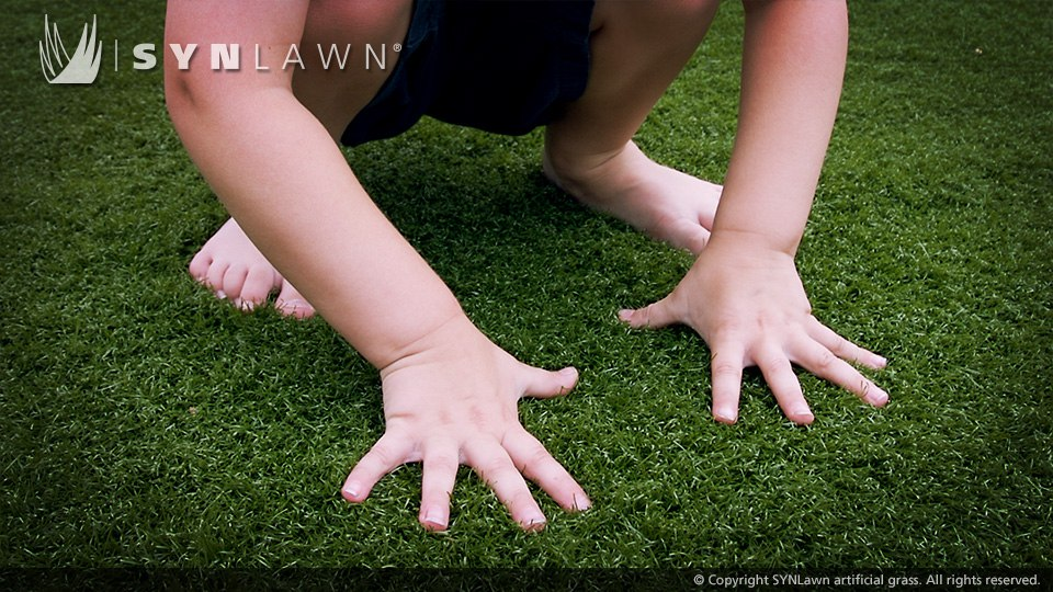 child playing in artificial turf