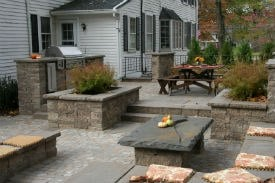 Multi-level paver patio with Walls, Outdoor Kitchen, Raised Planting Beds and Built-in Seating