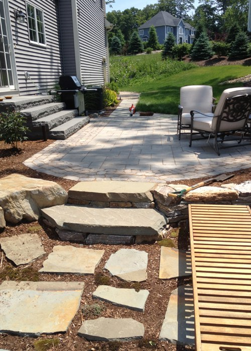 multi-level paver patio with natural stone steps to a smaller flagstone patio by bahler brothers in Connecticut