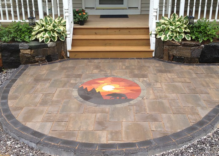 Front walkway with a Paver Art custom inlay. Installed by Bahler Brothers in East Hartland, CT