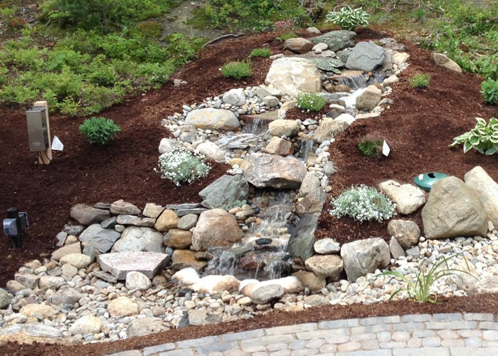 A mountain stream installed by Bahler Brothers in Burlington, CT.