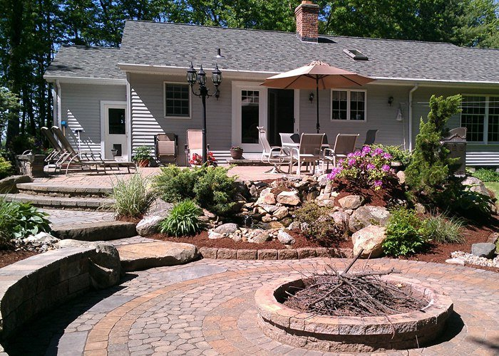 multi-level patio, fire pit, water feature and sitting wall by bahler brothers in Ellington, CT