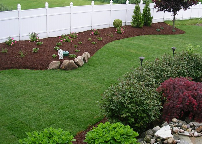 sod lawn installed along a curved landscape bed in South Windsor. installed by Bahler Brothers