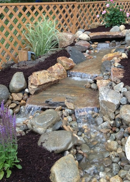 pondless water fall in Windsor Locks, CT. Installed by Bahler Brothers
