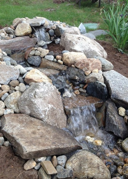 small pondless water feature installed by Bahler Brothers