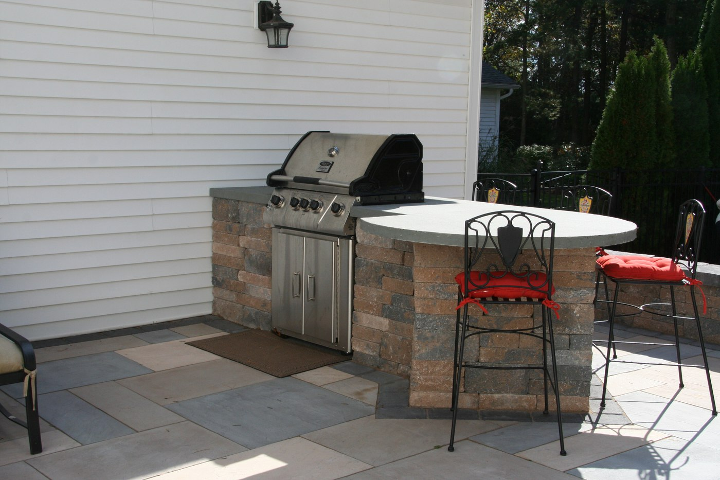 Outdoor Kitchen with Built-in Grill and Bar by Bahler Brothers in CT