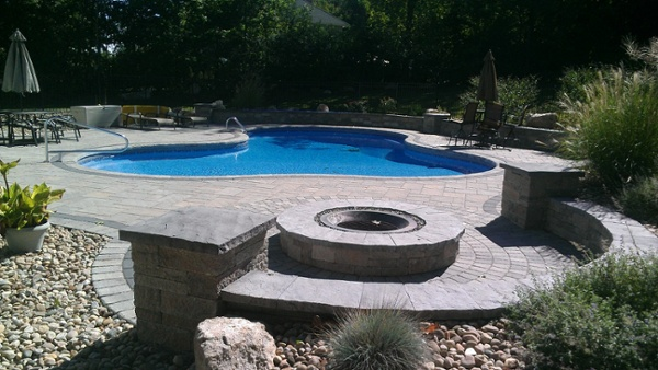 Paver pool patio with fire pit by Bahler Brothers in Bristol, CT