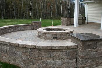 Paver patio with sitting wall and fire pit