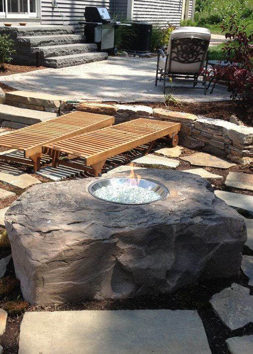 gas fire boulder and flagstone patio in Connecticut by Bahler Brothers