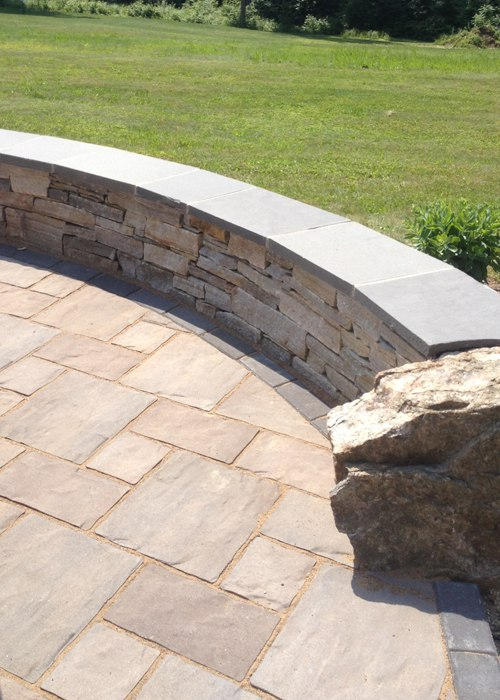 Stone Sitting Wall with a bluestone cap in CT by Bahler Brothers