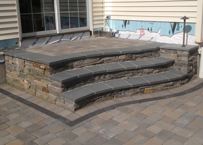 Bluestone capped Stone Steps on Paver Patio in South Windsor CT by Bahler Brothers