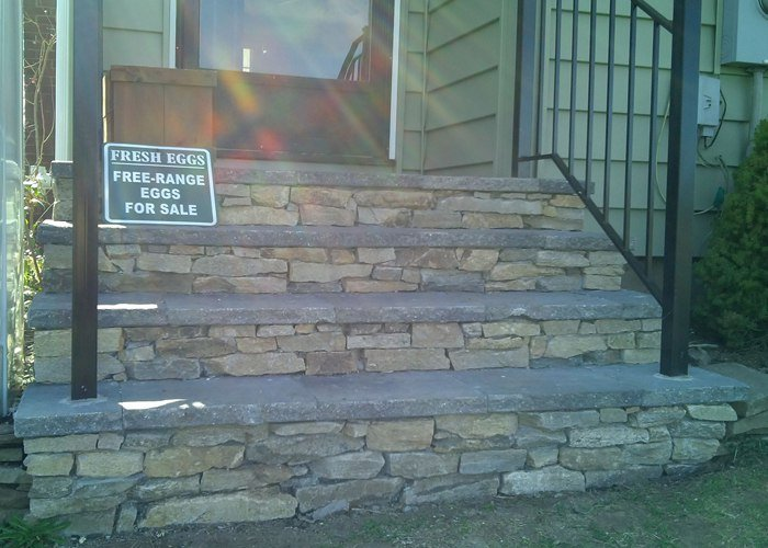 Bluestone treads and a thin Natural Stone Veneer covers an old concrete set of steps in Ellington, CT by Bahler Brothers