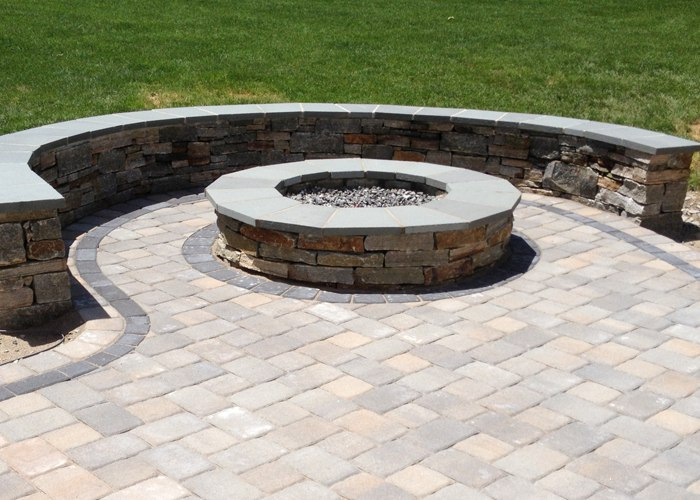 Stone Sitting Wall and Fire Pit on a paver patio in South Windsor CT by Bahler Brothers