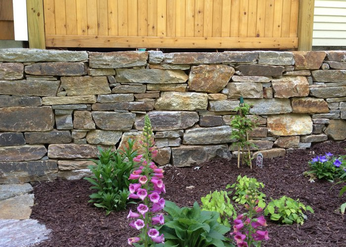 Field Stone Retaining Wall in Connecticut. by Bahler Brothers