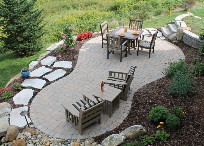an overview look at a small paver patio by bahler brothers in Bloomfield, CT