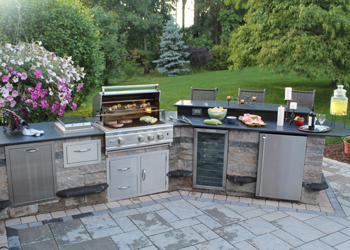 Outdoor Kitchen and Bar with Stainless Steel Grill and Stainless Steel Appliances on a Paver Patio by Bahler Brothers in South Windsor, CT