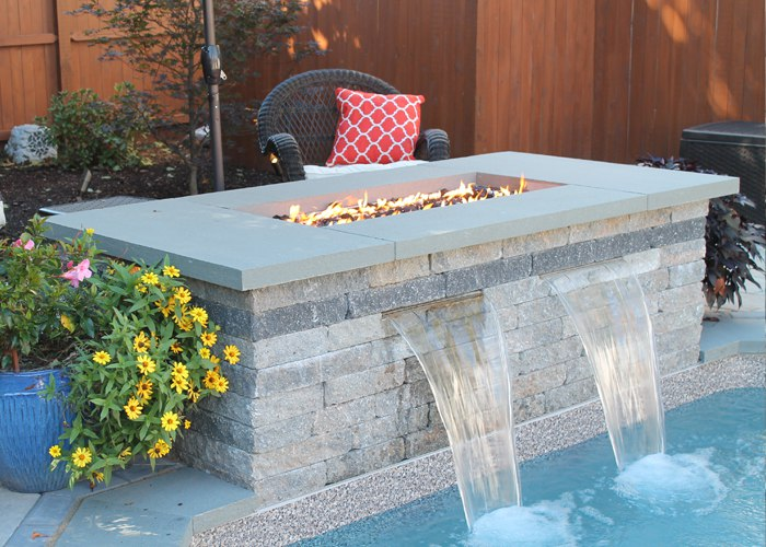 Fire and Water features combined to create a focal point at the end of a pool in West Hartford, CT. Installed by Bahler Brothers.