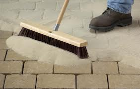 sweeping-poly-sand-into-paver-joints