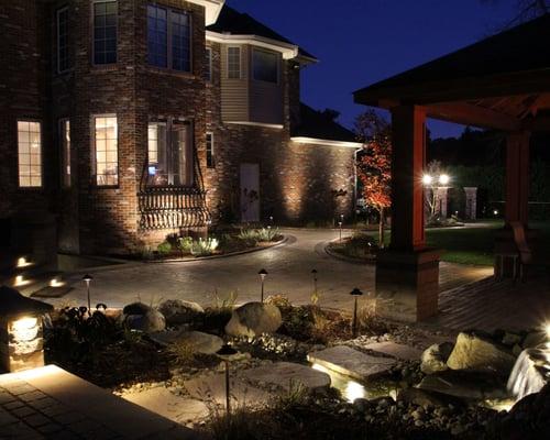 Brick home with patio lighting