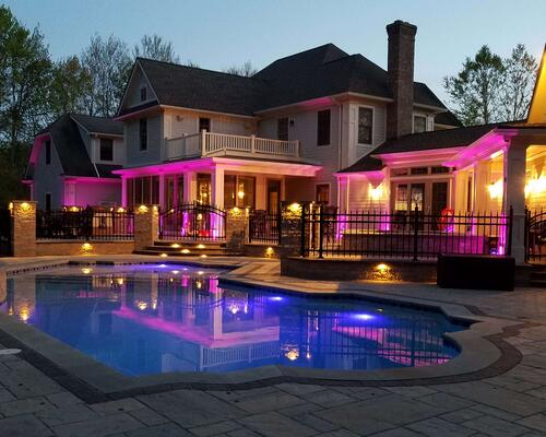 Patio and pool with colored lights