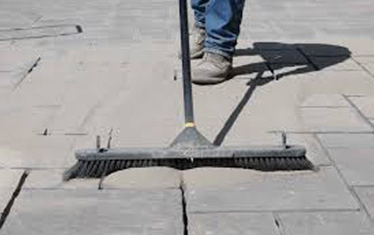 sweep poly sand into the paver joints